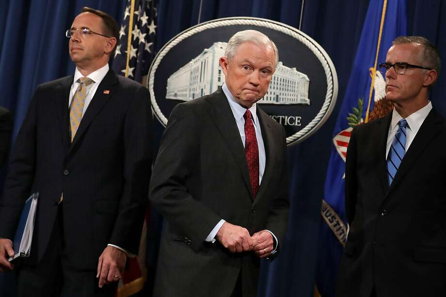 "Attorney General Jeff Sessions (center), shown with Deputy At tor ney General Rod Rosenstein (left) and acting FBI Di rec tor Andrew McCabe, will stay ""as long as that is appropriate."" Photo: Chip Somodevilla, Getty Images"