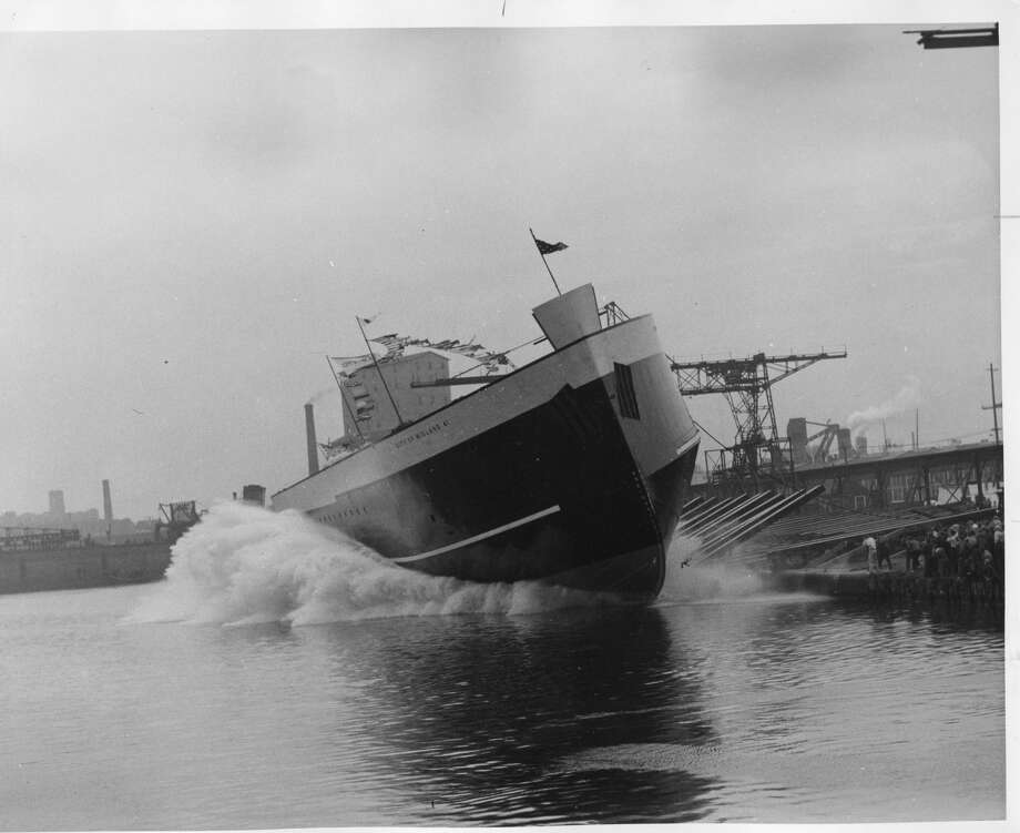 Amid foam and flying scud, the world's largest carferry, City of Midland, flagship of the Pere Marquette Railway Co.'s Lake Michigan fleet, strikes the water of the Manitowoc River at her ceremonious launching at Manitowoc, Wisconsin, Sept. 18, 1940. Five thousand spectators and another 18,000 perched atop the high east bank. (September 18, 1940) Photo: Daily News File Photos