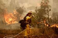 Cal Fire strike team leader Zack O'Neill works a fire line as firefighters continue to battle the Detwiler Fire on the outskirts of Mariposa, Ca., on Wednesday July 19, 2017.