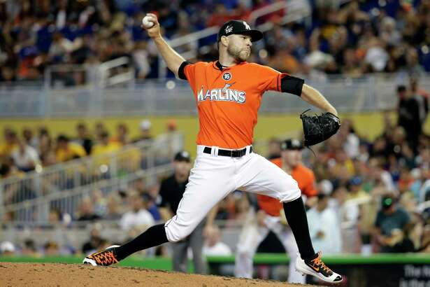 FILE - In this April 30, 2017, file photo, Miami Marlins relief pitcher David Phelps throws during a baseball game against the Pittsburgh Pirates, in Miami. The Miami Marlins traded right-hander David Phelps to the Seattle Mariners for four prospects, including highly regarded outfielder Brayan Hernandez, a person familiar with the deal said Thursday, July 20, 2017. The person confirmed the trade to The Associated Press on condition of anonymity. (AP Photo/Lynne Sladky, File)