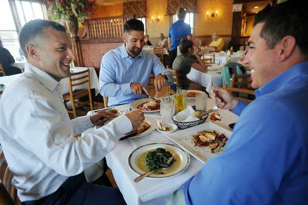 From left; Dave Rancourt, of Enfield, Joe Mish, of Wilton, and Carl Sturino, of New Milford, enjoy lunch during Dine Out Milford week at Gusto Trattoria Italian Restaurant in Milford, Conn. on Wednesday, July 19, 2017. During the week of July 17 to July 23 the restaurant, along with others in the city, features discounted prix fixe lunch and dinner menus.