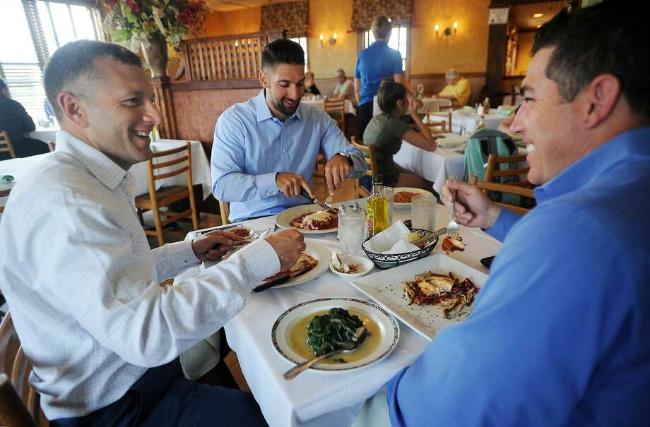 From left; Dave Rancourt, of Enfield, Joe Mish, of Wilton, and Carl Sturino, of New Milford, enjoy lunch during Dine Out Milford week at Gusto Trattoria Italian Restaurant in Milford, Conn. on Wednesday, July 19, 2017. During the week of July 17 to July 23 the restaurant, along with others in the city, features discounted prix fixe lunch and dinner menus: Serving Lunch for $17.95 and Dinner for $27.95.MenuClick through the slideshow to see the other restaurants offering deals during Dine Out Milford. Photo: Brian A. Pounds / Hearst Connecticut Media / Connecticut Post