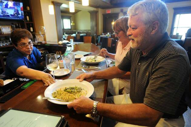 Don and Beverly Anderson, of Stratford, enjoy lunch during Dine Out Milford week at Gusto Trattoria Italian Restaurant in Milford, Conn. on Wednesday, July 19, 2017. During the week of July 17 to July 23 the restaurant, along with others in the city, features discounted prix fixe lunch and dinner menus.