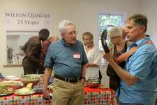 Sean Higgin sings a song with ... on the guitar at the Wilton Quaker Monthly Meeting's 75th anniversary Saturday, July 15, 2017, at 317 New Canaan Road.