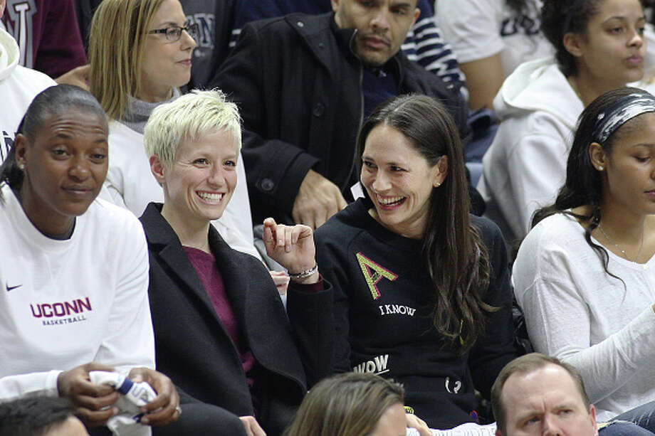 STORRS, CONNECTICUT- FEBRUARY 13: United States soccer player Megan Rapinoe with former UConn basketball players Sue Bird and Maya Moore, watching the UConn side as they go for their one hundreth consecutive win during the UConn Huskies Vs South Carolina Gamecocks NCAA Women's Basketball game at Gampel Pavilion, on February 13th, 2017 in Storrs, Connecticut. (Photo by Tim Clayton/Corbis via Getty Images) Photo: Tim Clayton - Corbis/Corbis Via Getty Images