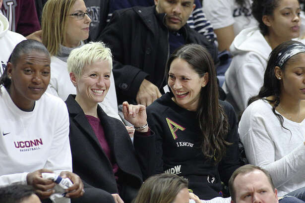 STORRS, CONNECTICUT- FEBRUARY 13: United States soccer player Megan Rapinoe with former UConn basketball players Sue Bird and Maya Moore, watching the UConn side as they go for their one hundreth consecutive win during the UConn Huskies Vs South Carolina Gamecocks NCAA Women's Basketball game at Gampel Pavilion, on February 13th, 2017 in Storrs, Connecticut. (Photo by Tim Clayton/Corbis via Getty Images)