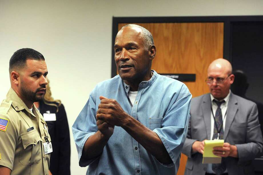 Former NFL football star O.J. Simpson reacts after learning he was granted parole at Lovelock Correctional Center in Lovelock, Nev., on Thursday, July 20, 2017.  Simpson was convicted in 2008 of enlisting some men he barely knew, including two who had guns, to retrieve from two sports collectibles sellers some items that Simpson said were stolen from him a decade earlier.   (Jason Bean/The Reno Gazette-Journal via AP, Pool) Photo: Jason Bean, POOL / USA TODAY NETWORK