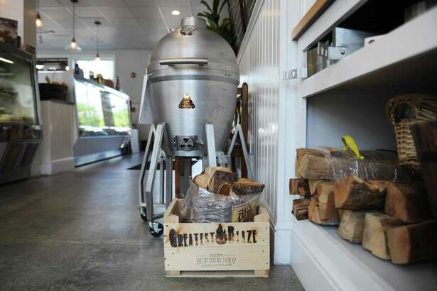 Greatest Blaze products are displayed at the Darien Butcher Shop in Darien, Conn. Thursday, July 20, 2017. The Byram-based firewood and outdoor entertainment brand branched out to sell its products in the Darien Butcher Shop starting in mid-June.