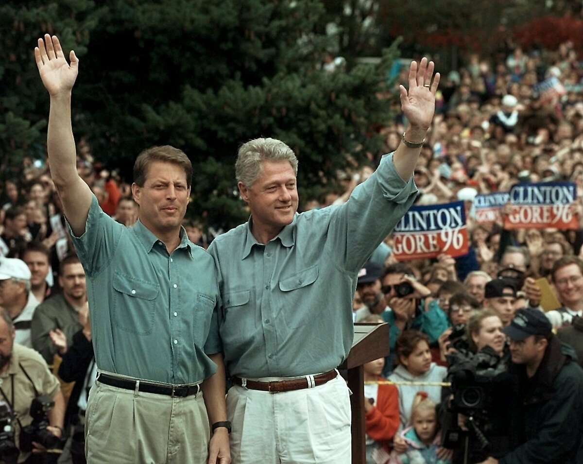 Vice President Al Gore and President Clinton wave after a campaign event in Yelm, Wash., in 1996.