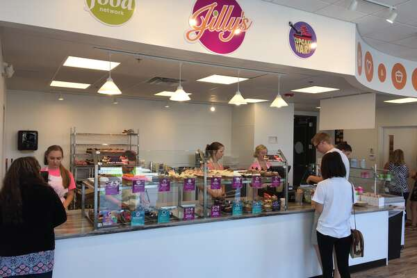 """Customers enjoy cupcakes and ice cream at Jilly's. The shop is the newest edition to the Edwardsville food scene and is located in the Madison Mutual Building on the corner of Buchanan St. and E. Park Street. Jilly's serves award-winning cupcakes and Chefs Casey Shiller and Dana Holland are two-time winners of the Food Network's """"Cupcake Wars."""""""