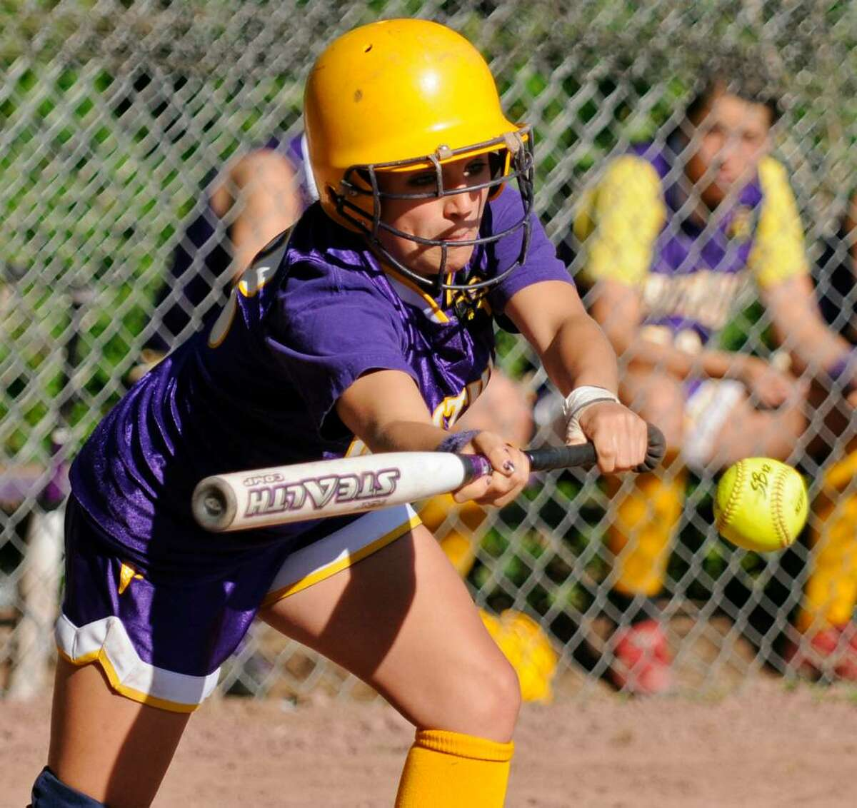 Westhill High School's Ali Souza lays down a bunt during Wednesday's game against Trumbull High School.