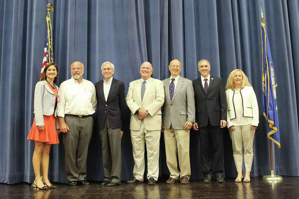 Democratic candidates received their endorsements at the DTC caucus in the town hall of Darien, Conn. on July 19, 2017.From left: Jennifer Leahy, Glenn Ritch, Frank Huck, Michael Burke, Marc Thorne, Rob Richards and Pam Sparkman