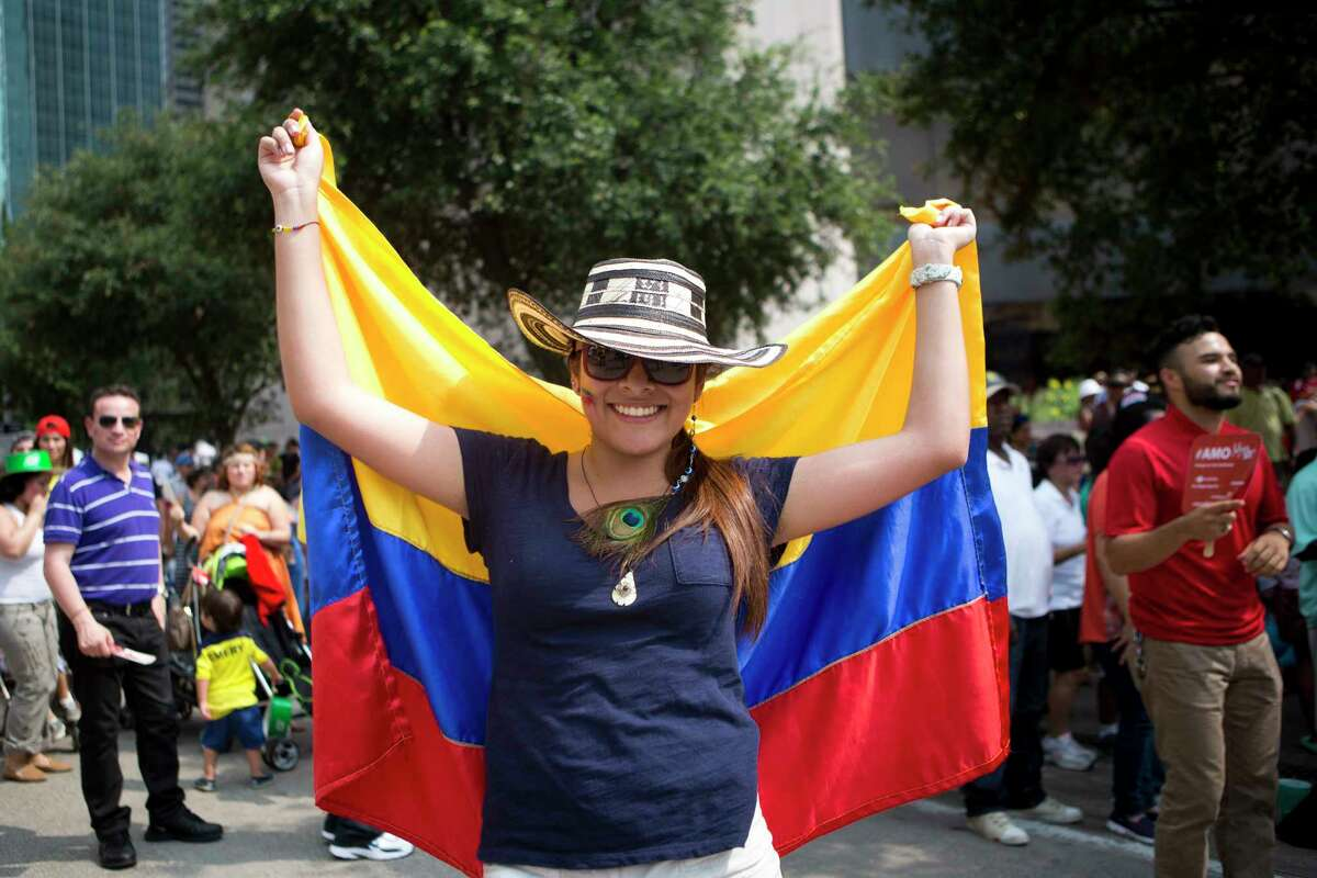 Carolina Linares, right, 19, shows off her pride for her Colombian heritage at the Colombian Fest 2014, Sunday, July 20, 2014, in Houston. ( Marie D. De Jesus / Houston Chronicle )