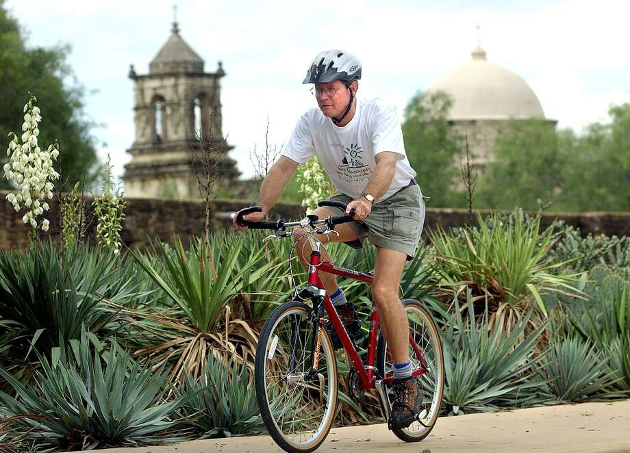 Murphy Emmons, a member of Los Compadres and one-time board chairman, rides his bike near Mission San Jose in 2002. Photo: Tom Reel / San Antonio Express-News / SAN ANTONIO EXPRESS-NEWS