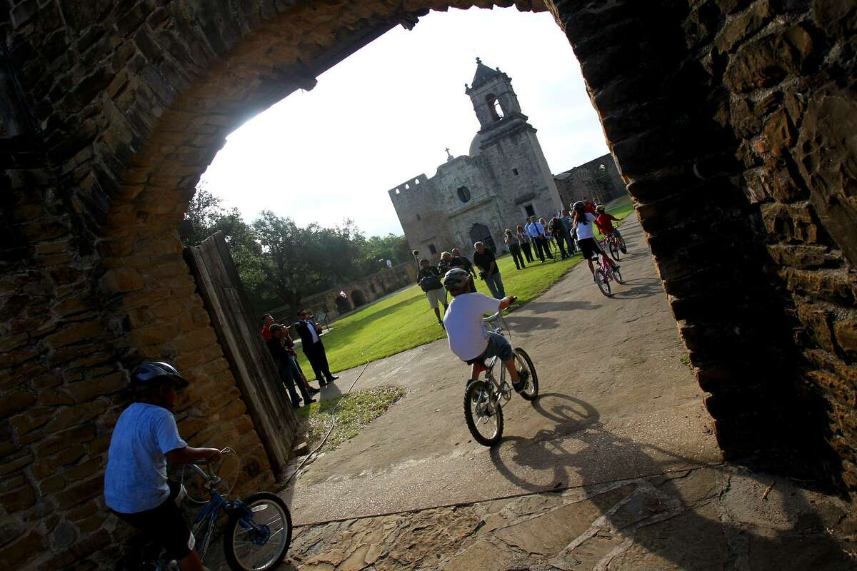 Cyclists enter the grounds of Mission San Jose in 2011 after starting a morning ride at Mission Concepción. Members of the San Antonio Cycling Club, the Mayor's Fitness Council and others made the ride to celebrate a $10,000 recreation grant that was donated by Coca-Cola to Los Compadres de San Antonio Missions for park enhancements.