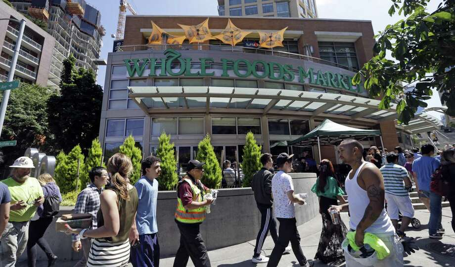 The merger with Whole Foods gives Amazon access to nationwide footprint of about 440 stores and puts them within spitting distance of many of its Prime customers, analysts say. Photo: Elaine Thompson /Associated Press / Copyright 2017 The Associated Press. All rights reserved.