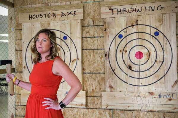 Chronicle features writer Maggie Gordon tries her hand at axe throwing at Houston Axe on Monday, July 17, 2017, in Houston. ( Brett Coomer / Houston Chronicle )