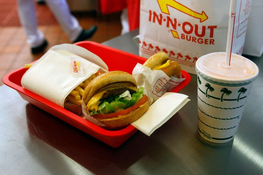 An order is seen during the grand opening Thursday Nov. 20, 2014 of San Antonio's first In-N-Out Burger. The store, located on Culebra just outside Loop 1604, opened at 9 a.m. because of the large crowds of people already in line for the store's normal 10 a.m. opening. Photo: William Luther, San Antonio Express-News