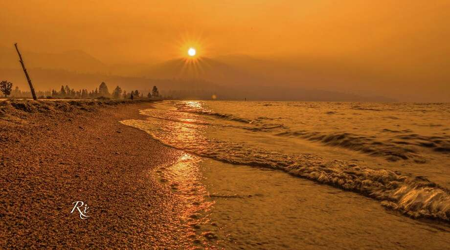 Smoke from a wildfire burning in Mariposa County blew into the Tahoe Basin and created a spectacular sunset. South Lake Tahoe photographer Kurt Rix of Amazing Imagery captured the photo on July 19, 2017. Photo: Kurt Rix / Amazing Imagery