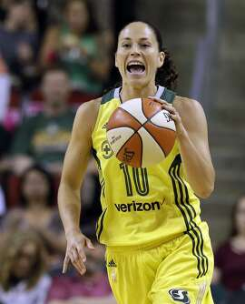 Seattle Storm's Sue Bird lets out a yell as she moves the ball up court against the Chicago Sky during the first half of a WNBA basketball game Tuesday, July 18, 2017, in Seattle. (AP Photo/Elaine Thompson)