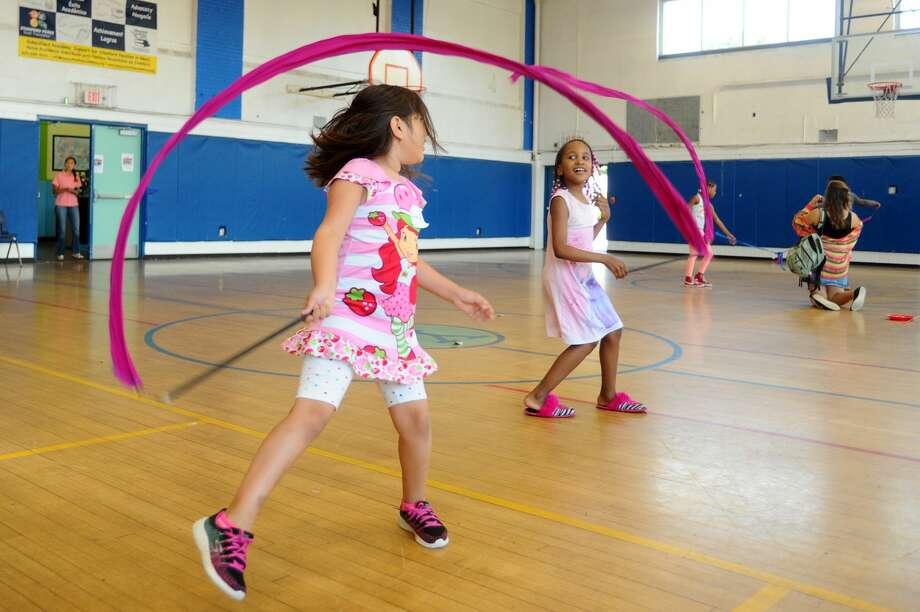 Kids practice circus tricks, including plate spinning and feather balancing, inside the Yerwood Center as part of The Palace's Circus Camp program in Stamford, Conn. on Thursday, July 20, 2017. Photo: Michael Cummo/Hearst Connecticut Media