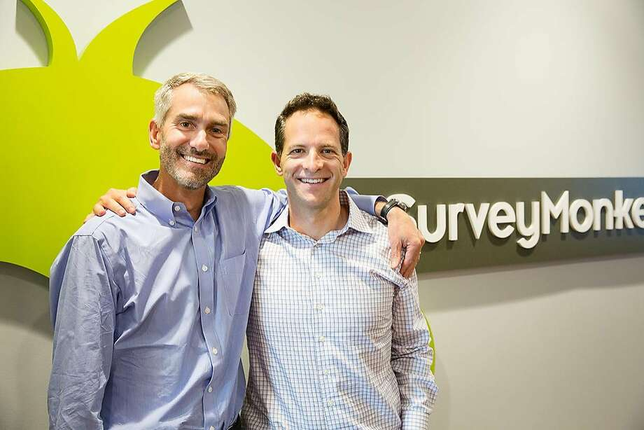 Zander Lurie, now CEO of SurveyMonkey, stands with his predecessor, Bill Veghte, at the company's former Palo Alto offices. Lurie took over as chairman, with Veghte as CEO, after the 2015 death of longtime leader Dave Goldberg; then Lurie took over as CEO after Veghte's departure. Photo: Photo By SurveyMonkey
