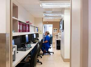 Dawn Nagel has worked as a nurse at St. Joseph Hospital for 18 years and as part of the hospital's sepsis unit since 2015. She tracks patients and starts antibiotics, takes labs, gives fluids and checks on patients, all on a strict timetable to reduce patients' chances of going into septic shock. (Heidi de Marco/Kaiser Health News/TNS)