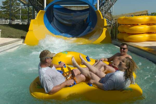 Spring  Cry about how you miss Waterworld while you speed down a slide at Wet N' Wild SplashTown, formerly Six Flags SplashTown.