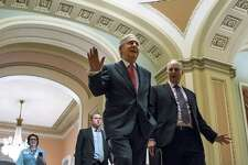 Senate Majority Leader Mitch McConnell heads to the Senate floor, on Capitol Hill Wednesday. The demise of the Senate's health care bill should spark a new bipartisan effort to fix the Affordable Care Act.