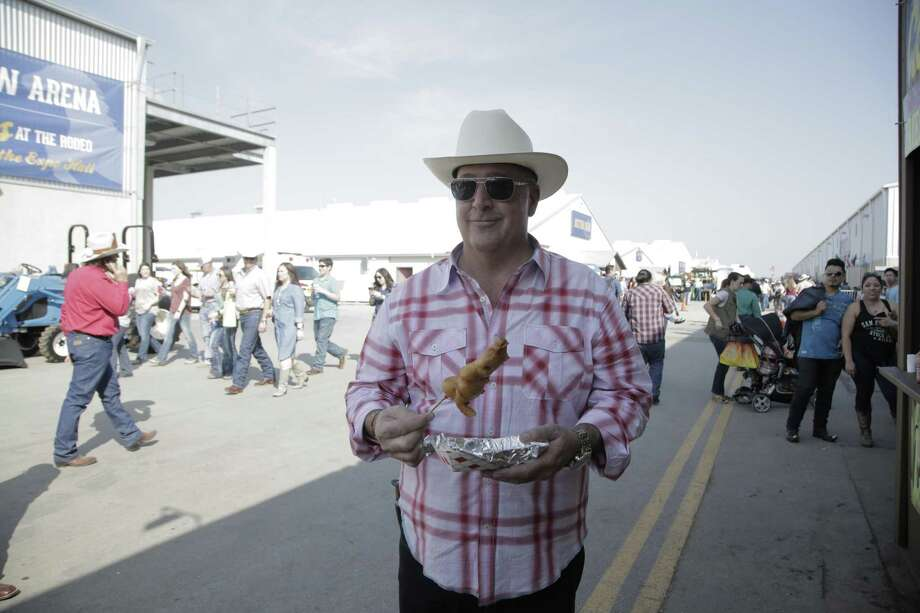 """""""Bizarre Foods"""" host Andrew Zimmern enjoys succulent gator bites at the San Antonio Stock Show and Rodeo. Photo: Travel Channel"""