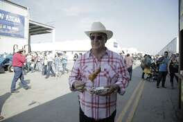 """""""Bizarre Foods"""" host Andrew Zimmern enjoys succulent gator bites at the San Antonio Stock Show and Rodeo."""