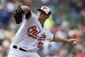 BALTIMORE, MD - JULY 16: Zach Britton #53 of the Baltimore Orioles throws a pitch to a Chicago Cubs batter in the seventh inning during a game at Oriole Park at Camden Yards on July 16, 2017 in Baltimore, Maryland. (Photo by Patrick McDermott/Getty Images)