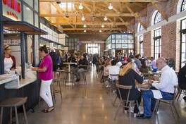 Lunchtime at a pre-opening event at The Bottling Department, a food hall at The Pearl.