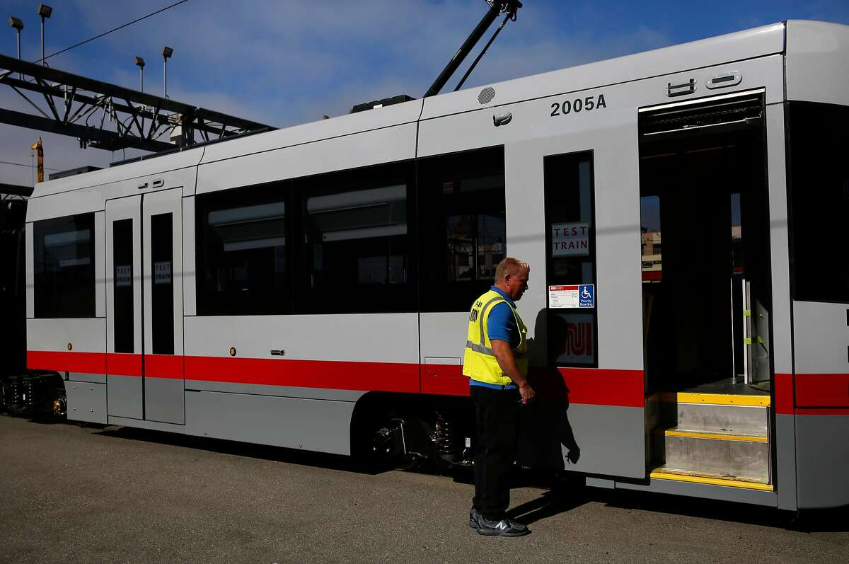 Assistant Supervisor David McElroy opens the door to a new MUNI train during a media tour at MUNI Metro East Maintenance Facility July 20, 2017 in San Francisco, Calif.