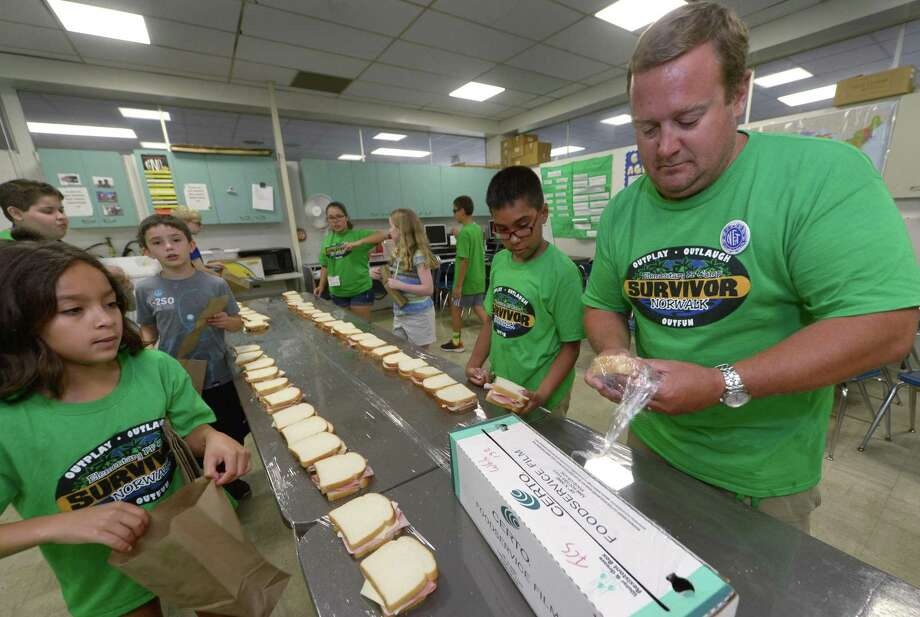 Ten year olds Sophia Negron and Sebastian Alvararez helps her teacher Ted White make sandwiches for the Community Advent Christian Church as part of cooking class during Norwalk Public Schools Personal Fulfillment Camp Friday, July 14, 2017, at Nathan Hale Middle School in Norwalk, Conn. Personal Fulfillment Camp is the only summer camp in the city staffed by certified public school teachers and aides. Photo: Erik Trautmann / Hearst Connecticut Media / Norwalk Hour