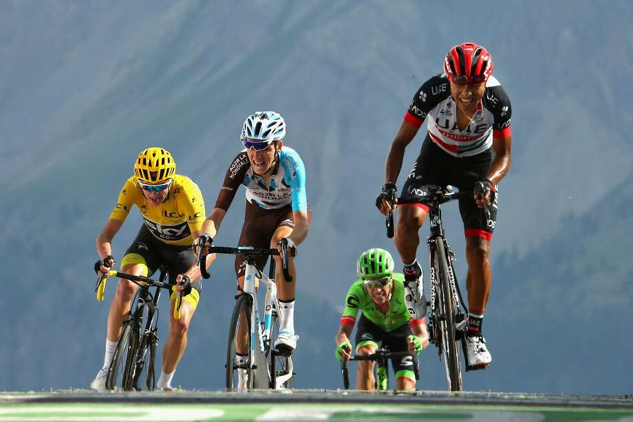 Race Leader Chris Froome (left), second place overall Romain Bardet (second from left), green jersey rider Michael Matthews and Colombia's Jhon Darwin Atapuma Hurtado huff and puff across the mountaintop finish line at Izoard. Photo: Chris Graythen, Getty Images