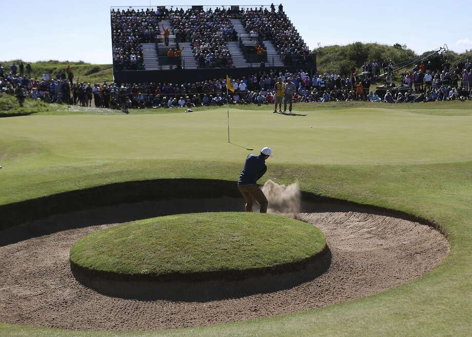 Northern Ireland's Rory McIlroy takes a whack out of the bunker on the 7th hole at Royal Birkdale in Southport, England, on his way to a 71. Photo: Peter Morrison, Associated Press