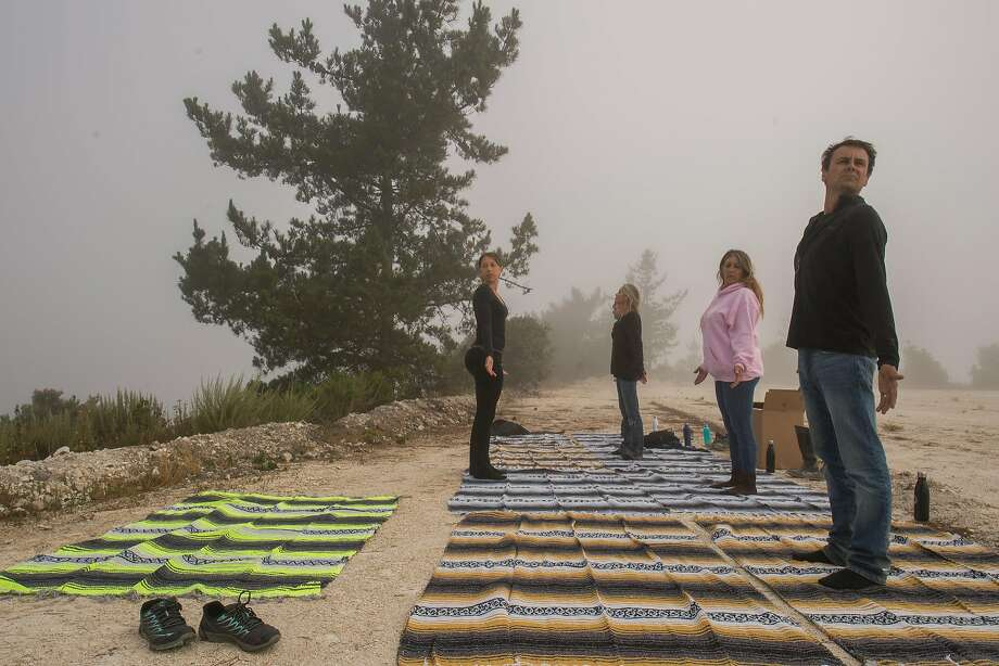 Danielle Mallett (left) instructs a morning yoga class with developer Nick Jekogian (right), Rose Bruno (second from right) and Michelle Armitage after a hike through Walden Monterey. Photo: Nic Coury, Special To The Chronicle