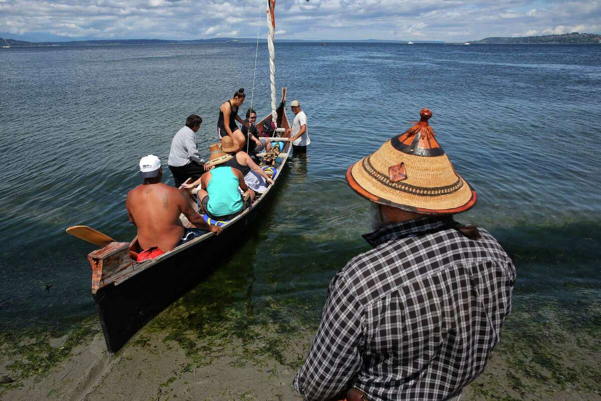 Canoe Journey families from the Muckleshoot, Suquamish, Puyallup, Squaxin, Skokomish and Nisqually Tribes leave from Alki Beach and head to Suquamish, the next stop on their journey to Campbell River on Vancouver Island, Thursday, July 20, 2017.
