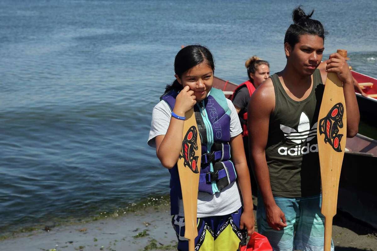 Canoe Journey families from the Muckelshoot, Suquamish, Puyallup, Squaxin, Skokomish and Nisqually Tribes leave from Alki Beach and head to Suquamish, the next stop on their journey to Campbell River on Vancouver Island, Thursday, July 20, 2017.