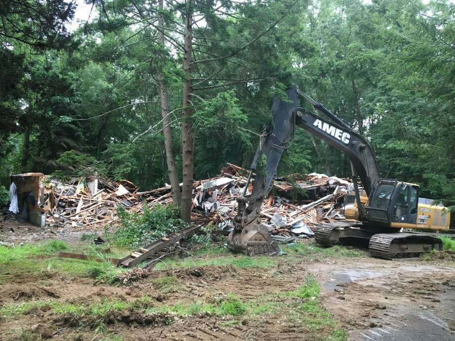 The historic White Barn Theater in Norwalk was demolished Thursday. Photo: Kevin Schultz