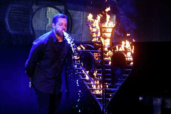Magician David Blaine puts out a fire by spraying out the copious amount of water that he drank at the Majestic Theatre on Wednesday, July 18, 2017. Blaine set the fire by drinking and spraying kerosene on top of the water. Blaine is on a 50-city tour.