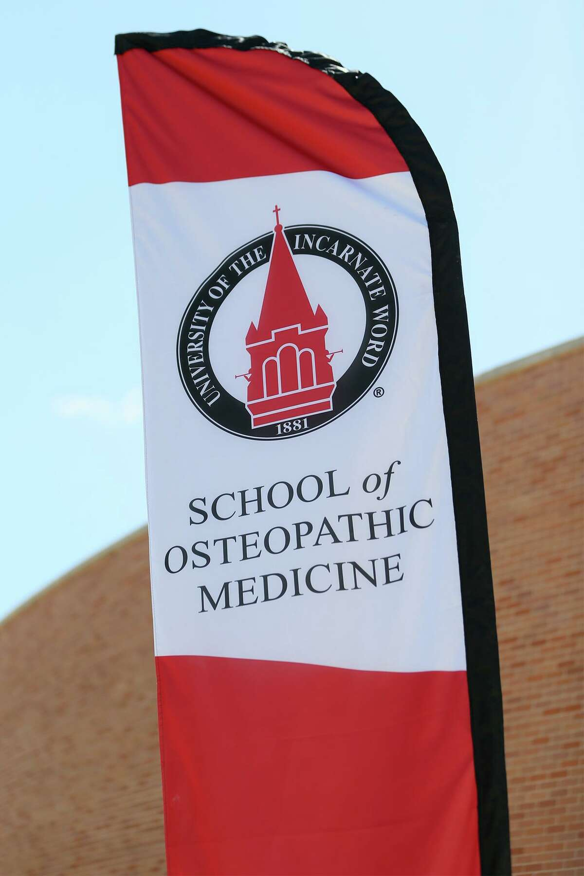A banner flies outside UIW's School of Osteopathic Medicine at Brooks. On Friday, the university announced it has purchased seven building at South Side mixed-use development to house its health professions programs.