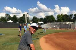Virgil Balke, shown here volunteering as a grounds crew worker at the UIL State Softball Championships this past spring, is the new softball coach at Porter High School.