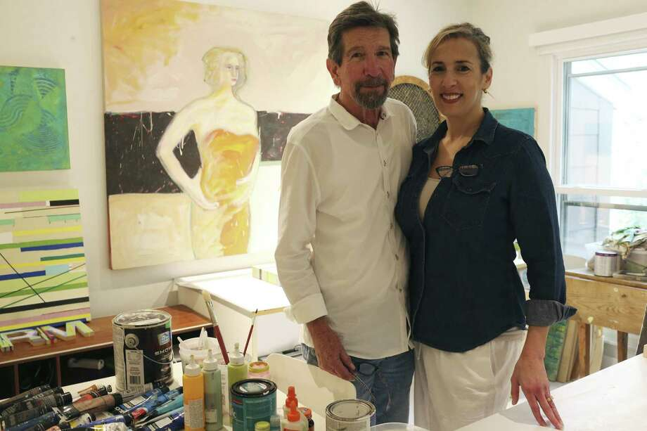 """Richard Mogas did the painting over his right shoulder in the early '70s when, he said, """"I was painting a lot of women."""" His wife Michele said that more than one visitor to their condo/studio has asked if it was her. She would've been about 10 years old at the time. Photo: Jerry Lara /San Antonio Express-News / San Antonio Express-News"""