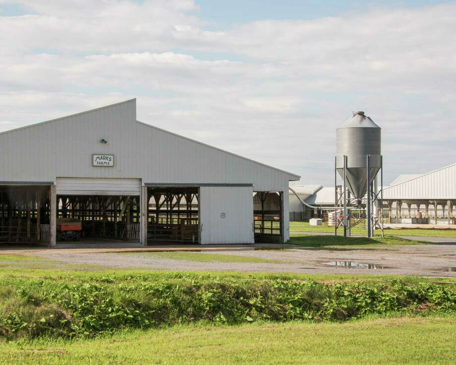Marks Farms, a dairy farm where Crispin Hernandez was fired from after gathering colleagues to discuss protesting working conditions, in Lowville, N.Y., July 15, 2017.  An 80-year-old state law has precluded laborers on farms from collective action. A lawsuit by the New York Civil Liberties Union could end it. (Shane Lavalette/The New York Times) ORG XMIT: XNYT182 Photo: SHANE LAVALETTE / NYTNS