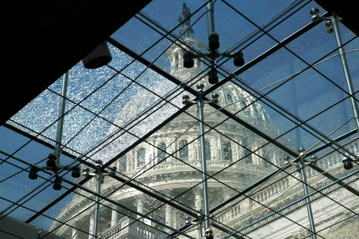 The U.S. Capitol is seen through glass panels, one of which is webbed with cracks, from below the Capitol Visitors Center, Thursday, July 20, 2017, in Washington. Sen. John McCain, the 2008 Republican presidential nominee, Vietnam prisoner of war and political maverick in Congress for more than three decades, has been diagnosed with an aggressive type of brain tumor. (AP Photo/Jacquelyn Martin)
