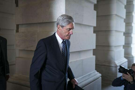 FILE — Robert Mueller, the former FBI director and special counsel who is leading the Russia investigation, leaves the Capitol in Washington, June 21, 2017. President Donald Trump's team is looking for information that could get investigators recused or justify firing Mueller, according to three people with knowledge of the research effort. (Doug Mills/The New York Times)