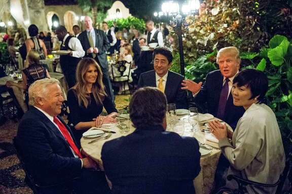 President Donald Trump dines with Japanese Prime Minister Shinzo Abe, center, and their spouses, Melania Trump and Akie Abe, in  February.