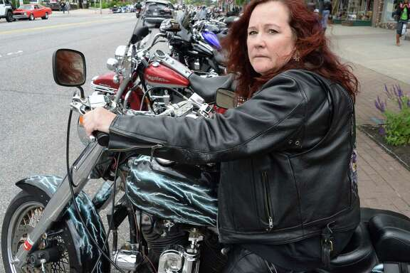 Mary Rose parks her Harley-Davidson Sportster in Lake George Village, NY. The U.S. has dropped part of a settlement with Harley-Davidson.